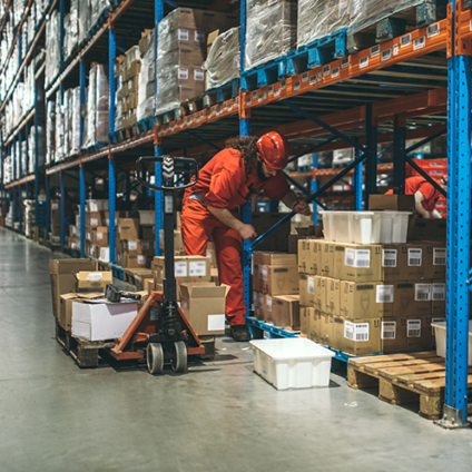man unloading boxes in warehouse